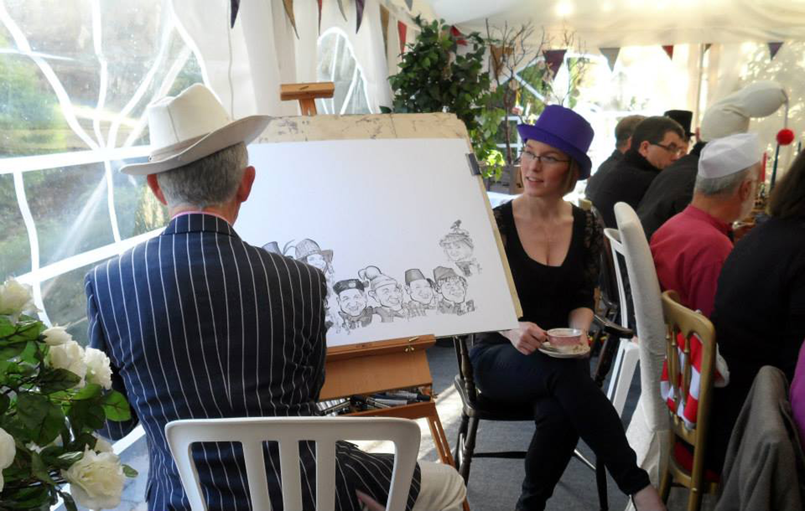 Chris caricature artist at Mad Hatters Tea Party 2014