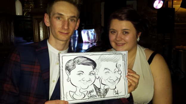 Wedding guests with their caricature