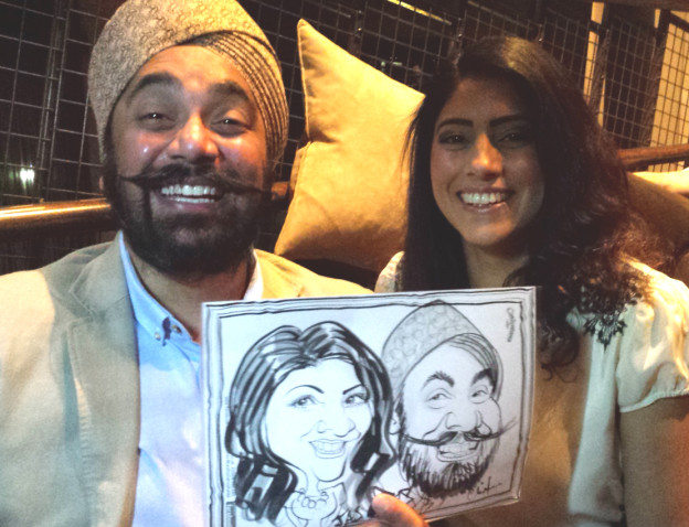 Guests with their caricature by Chris Murphy at Malmaison Hotel, Liverpool.