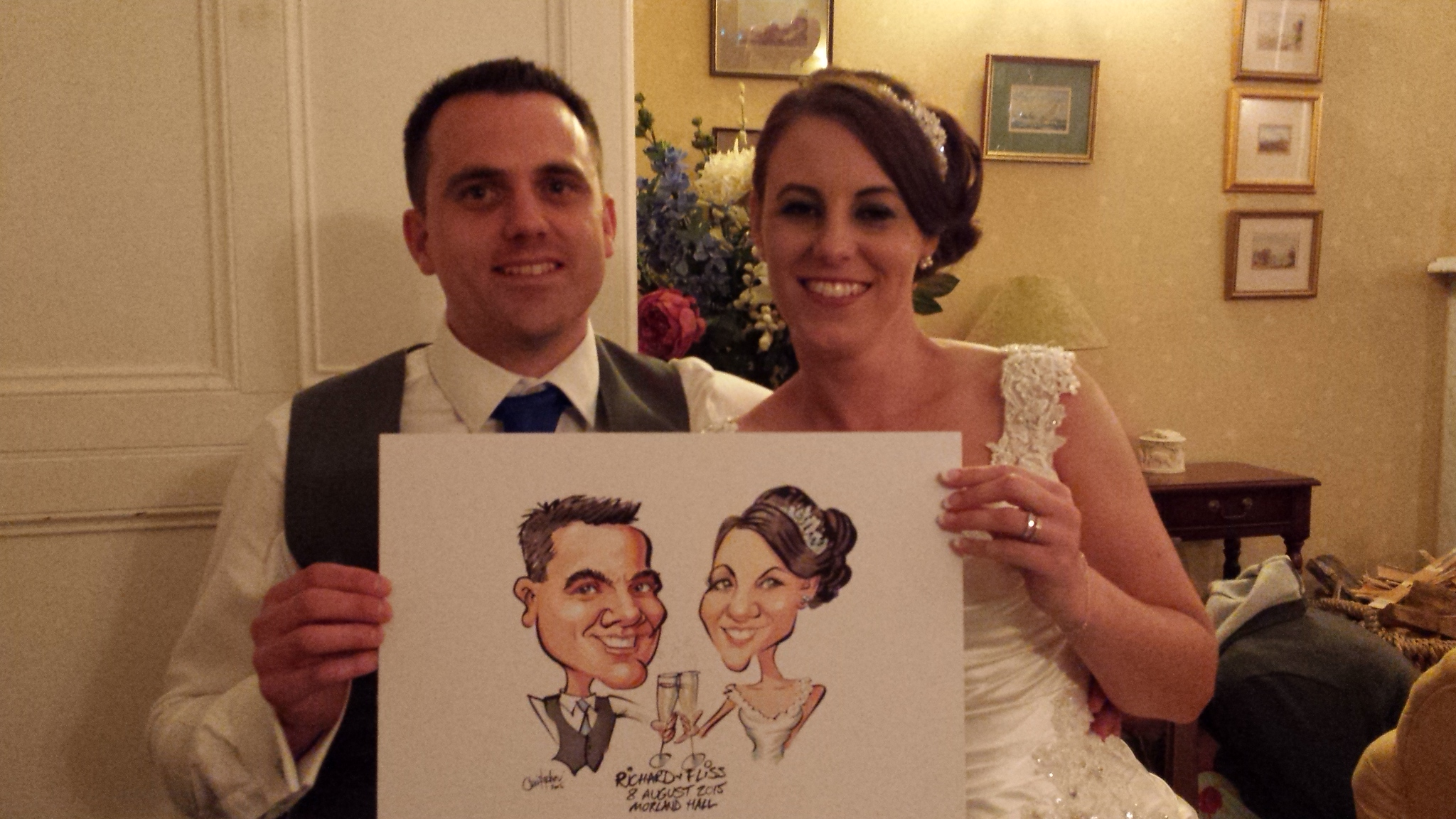 Colour caricature of bride and groom for guests to sign