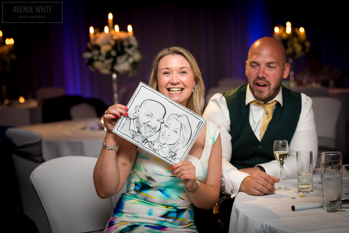 Guests with their caricature by Chris