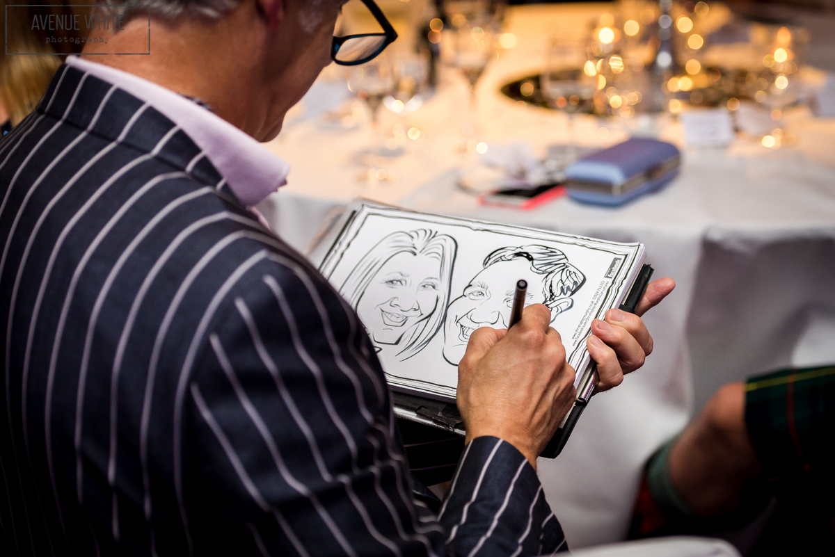 Caricaturist Chris Murphy drawing at a wedding