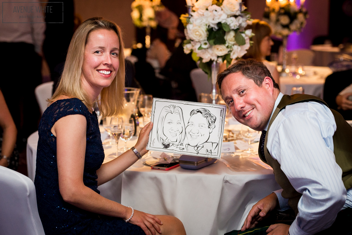 Guests with their caricature.