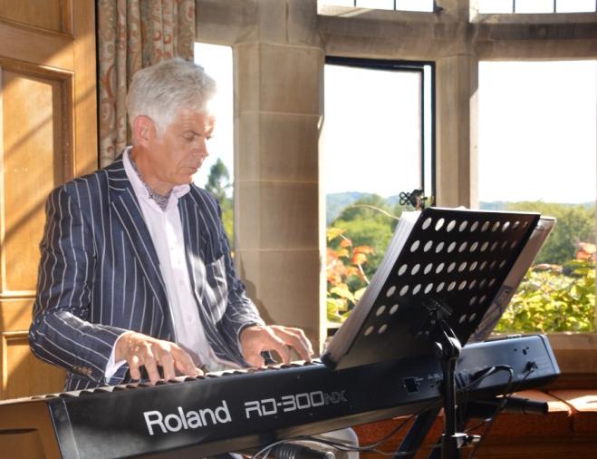 Chris playing piano at Cragwood
