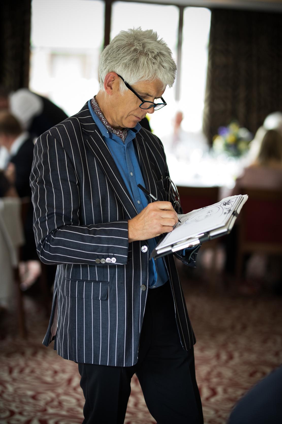 Chris drawing at a wedding